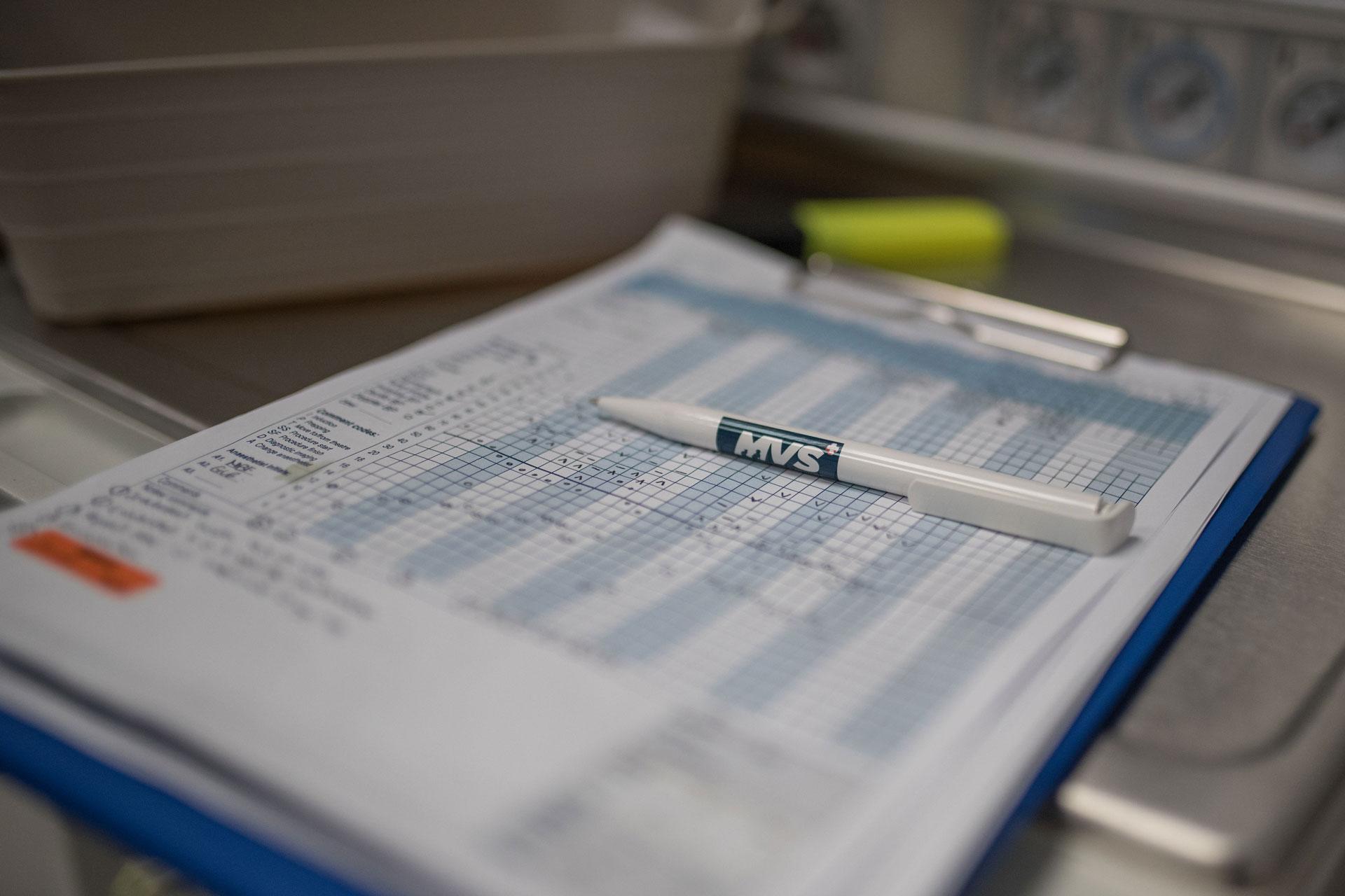 Pen on clipboard at vets